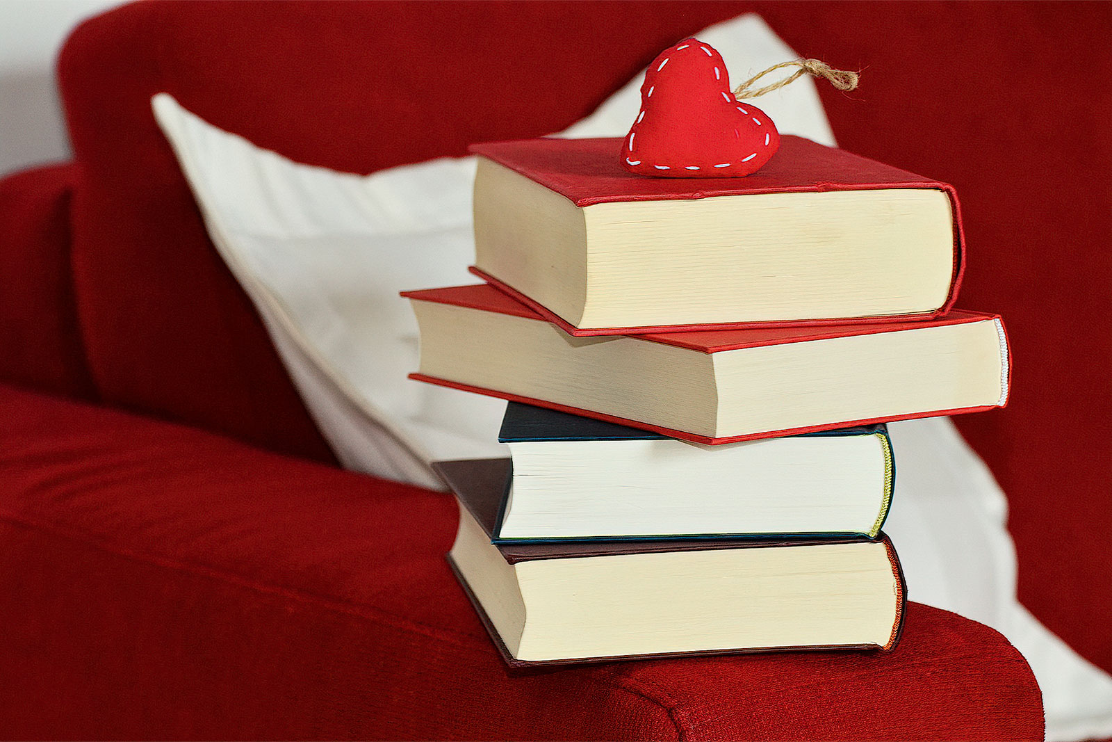 Stack of Books with Red Heart Decoration