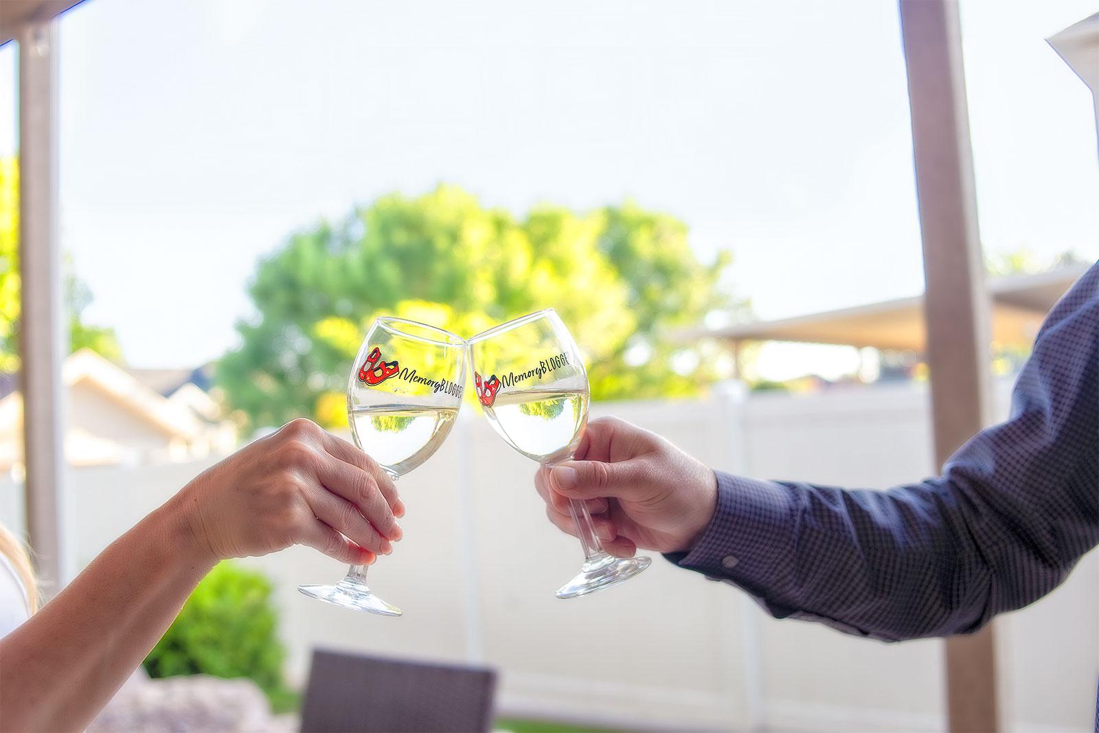 Couple Clinking MemoryBlogger Wine Glasses